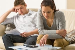 Stressed Payday loan couple calculating their finances